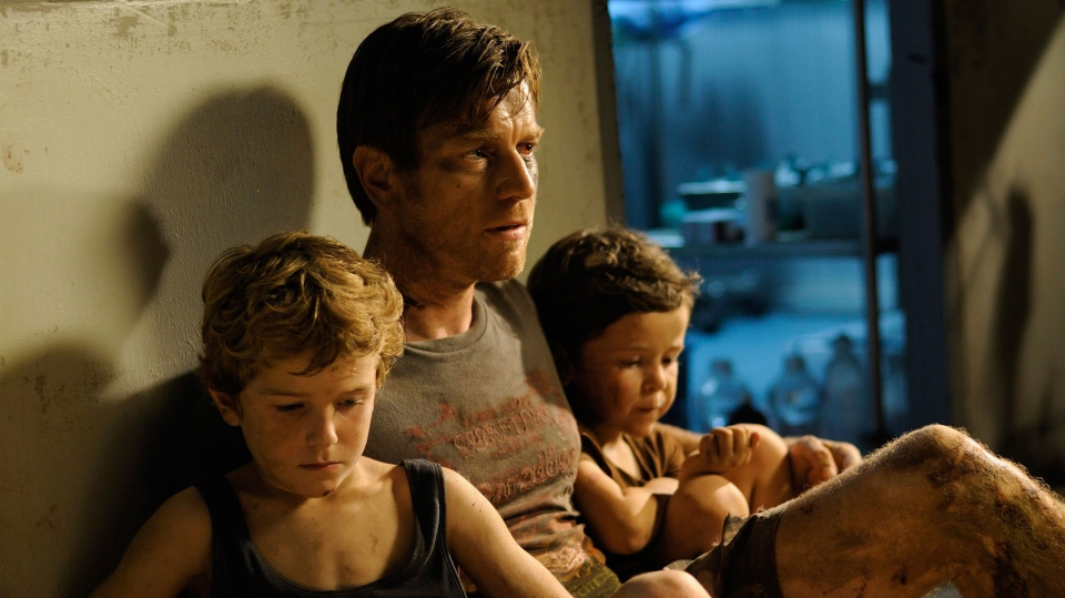 Samuel Joslin, Ewan McGregor, Oaklee Pendergast in a scene from Summit Entertainment's 'The Impossible'.