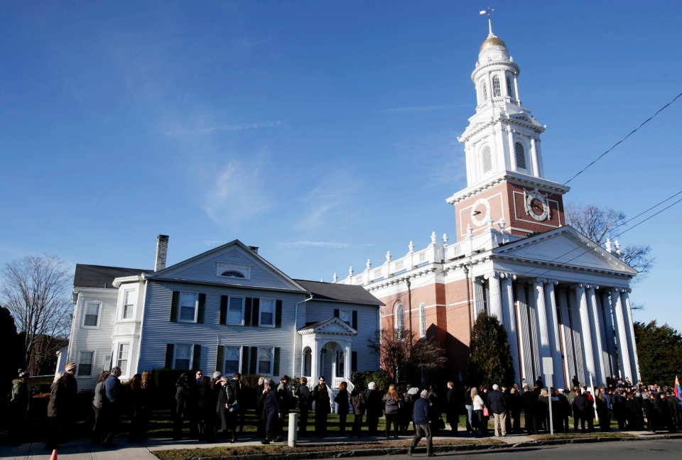 A long line stretches down the block in front of the First Congregational Church before a memorial service for Lauren Rousseau in Danbury, Conn., Thursday, Dec. 20, 2012. (AP / Seth Wenig)