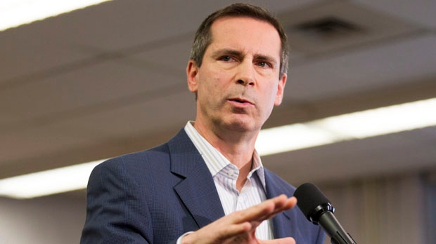 Ontario Premier Dalton McGuinty speaks to reporters at St. Fidelis Catholic Elementary School in Toronto on Thursday, Dec. 20, 2012. (The Canadian Press/Chris Young)