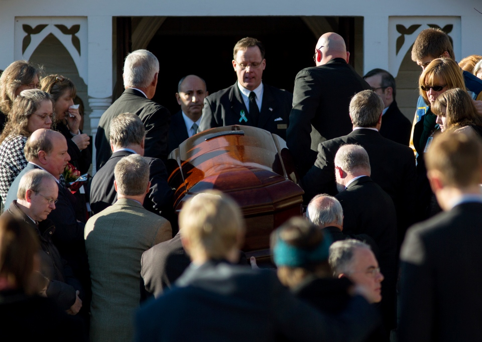 The casket of teacher Anne Marie Murphy is lifted into St. Mary Of The Assumption Church in Katonah, N.Y. Thursday, Dec. 20, 2012. (AP / Craig Ruttle)