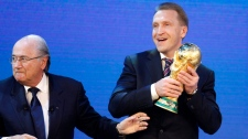 Russian Deputy Prime Minister Igor Shuvalov, right, holds the World Cup trophy beside FIFA president Joseph Blatter after the announcement of Russia to host the soccer World Cup 2018 in Zurich, Switzerland, Thursday, Dec.2, 2010. (AP / Michael Probst)