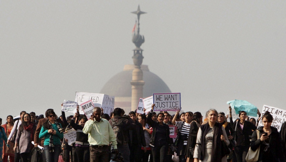 Activists of the All India Democratic Women's Association and Young Women's Christian Association (YWCA) and other people shout slogans as they take part in a protest march from the Presidential Palace to India Gate in New Delhi, India on Friday, Dec. 21, 2012. (AP Photo)