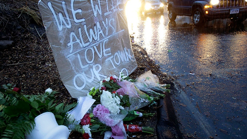 Heavy rains soaked a memorial to the shooting victims in the Sandy Hook village of Newtown, Conn., Friday, Dec. 21, 2012. (AP / Seth Wenig)
