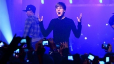 Justin Bieber performs at the Show Case in Paris Tuesday, Nov. 30, 2010. (AP / Jacques Brinon)