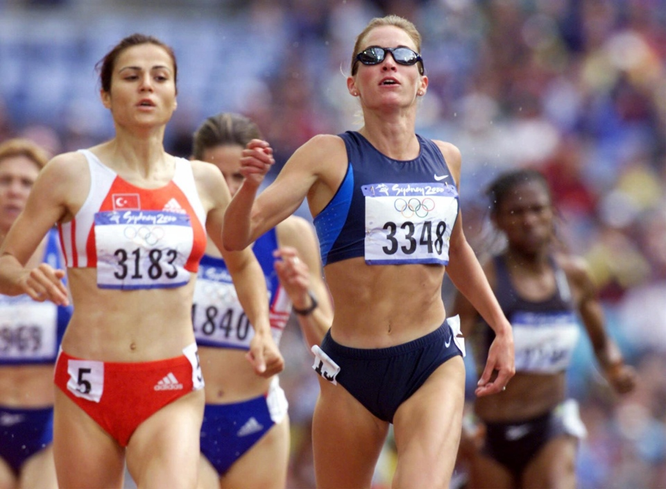 Suzy Favor Hamilton of the United States, right, and Sureyya Ayhan of Turkey, compete in a first round heat of the 1500m at the Summer Olympics at Olympic Stadium in Sydney on Wednesday, Sept. 27, 2000. (AP / Doug Mills)