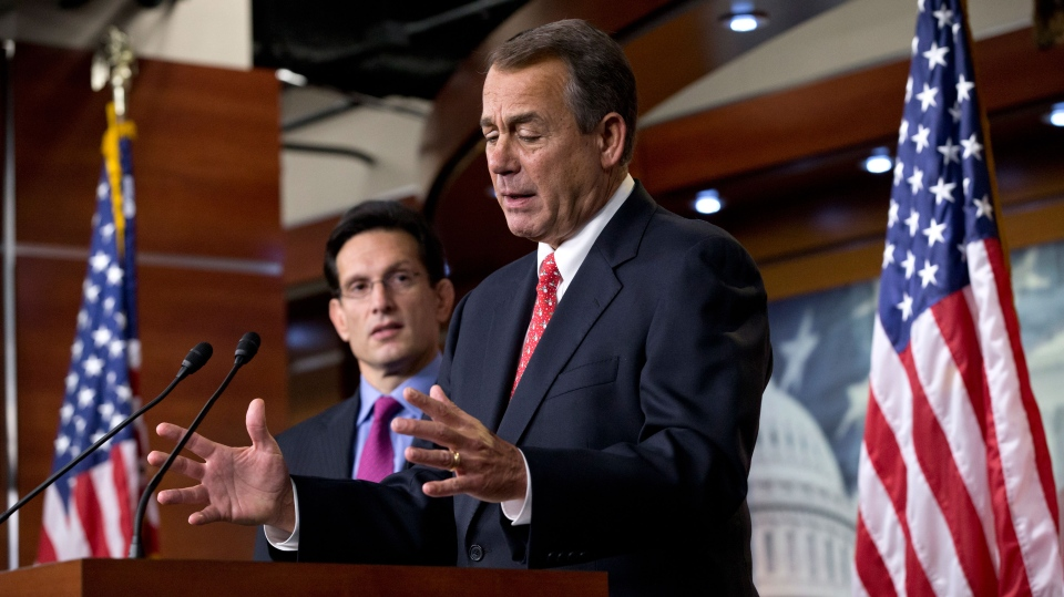 Speaker of the House John Boehner, joined by House Majority Leader Eric Cantor, left, speaks to reporters about the fiscal cliff negotiations at the Capitol in Washington, Friday, Dec. 21, 2012. (AP / J. Scott Applewhite)