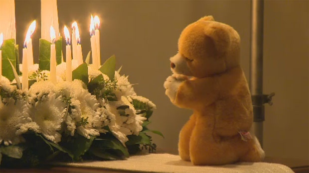Many mourners donated teddy bears to a candlelight vigil in honour of the Sandy Hook shooting victims.
