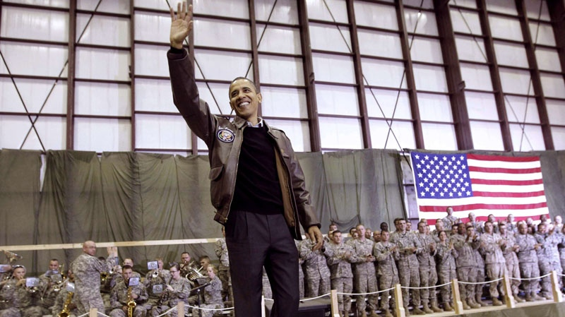 President Barack Obama waves as he is introduced to the troops at a rally during an unannounced visit at Bagram Air Field in Afghanistan, Friday, Dec. 3, 2010. (AP / Pablo Martinez Monsivais)
