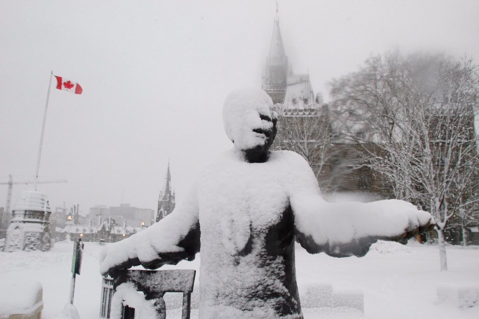 The statue of Louise McKinney, of the Famous Five, a politician and temperance campaigner, is covered in snow on Parliament Hill in Ottawa Friday Dec. 21, 2012. (Fred Chartrand / THE CANADIAN PRESS)