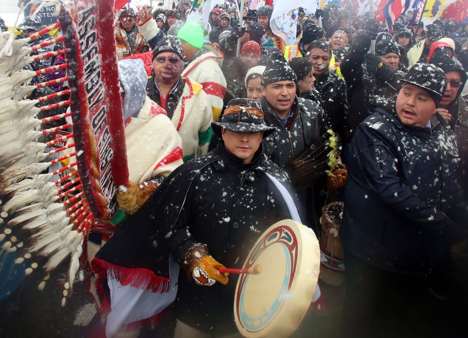 National Chief of the Assembly of First Nations Shawn Atleo, centre, drums as he takes part in a protest on Parliament Hill in Ottawa on Friday, Dec. 21, 2012. (Fred Chartrand / THE CANADIAN PRESS)