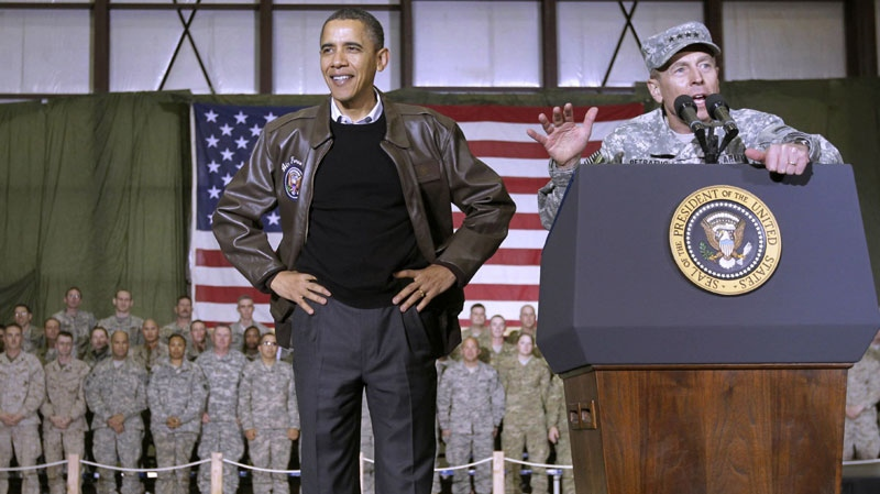 President Barack Obama is introduced to the troops by NATO Commander in Afghanistan Gen David Petraeus at a rally during an unannounced visit at Bagram Air Field in Afghanistan, Friday, Dec. 3, 2010. (AP / Pablo Martinez Monsivais)
