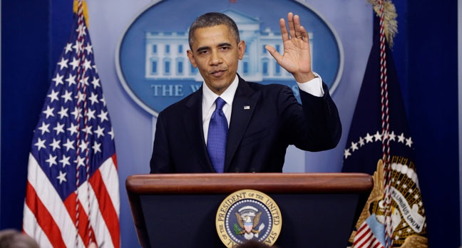 President Barack Obama waves as he leaves the podium after speaking about the fiscal cliff in the Brady Press Briefing Room at the White House in Washington, Friday, Dec. 21, 2012. (AP / Charles Dharapak)