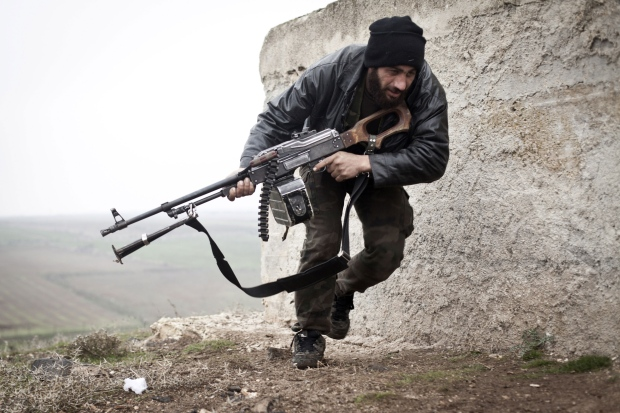 Free Syrian Army fighter takes cover