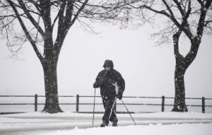 A man walks along Lakeshore Boulevard as snow falls in Montreal Friday, December, 21, 2012. (Graham Hughes / THE CANADIAN PRESS).