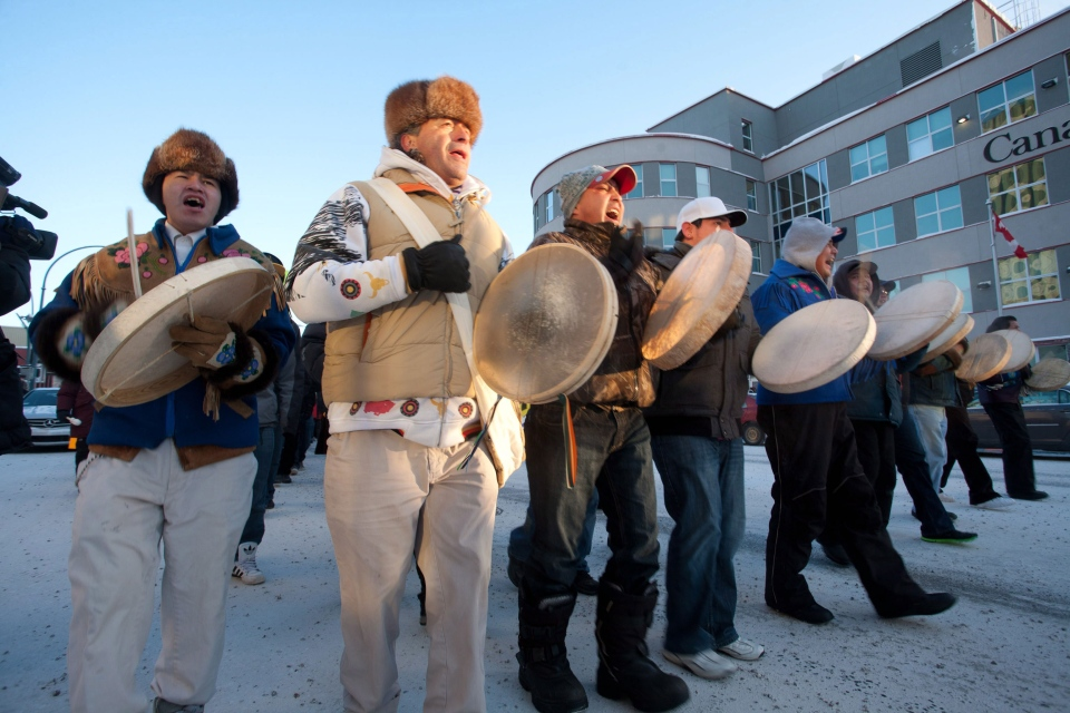 About 100 people march in a demonstration, lead by Dene National Chief Bill Erasmus, second left, during -29 C degree weather in downtown Yellowknife on Friday December 21, 2012. (Bill Braden / THE CANADIAN PRESS)
