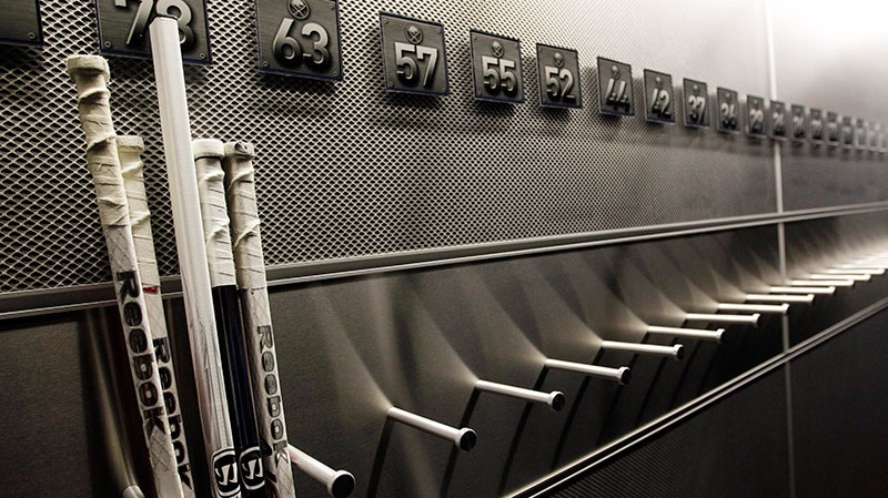 A nearly empty hockey stick rack in the locker room of the Buffalo Sabres hockey team is shown during the NHL labor lockout in Buffalo, N.Y., Sept. 25, 2012. (AP / David Duprey)