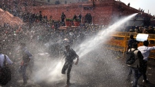 Poice disperse protesters New Delhi