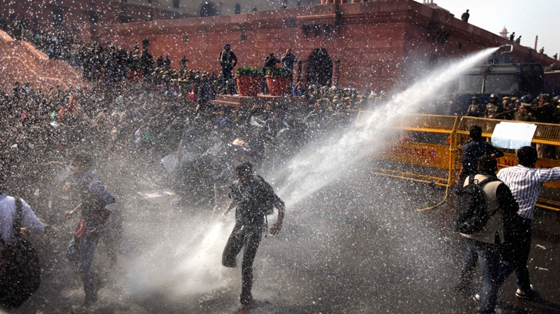 Protesters are dispersed by Indian police's water cannon during their march towards the Presidential Palace in New Delhi, India, Saturday, Dec. 22, 2012. (AP / Altaf Qadri)