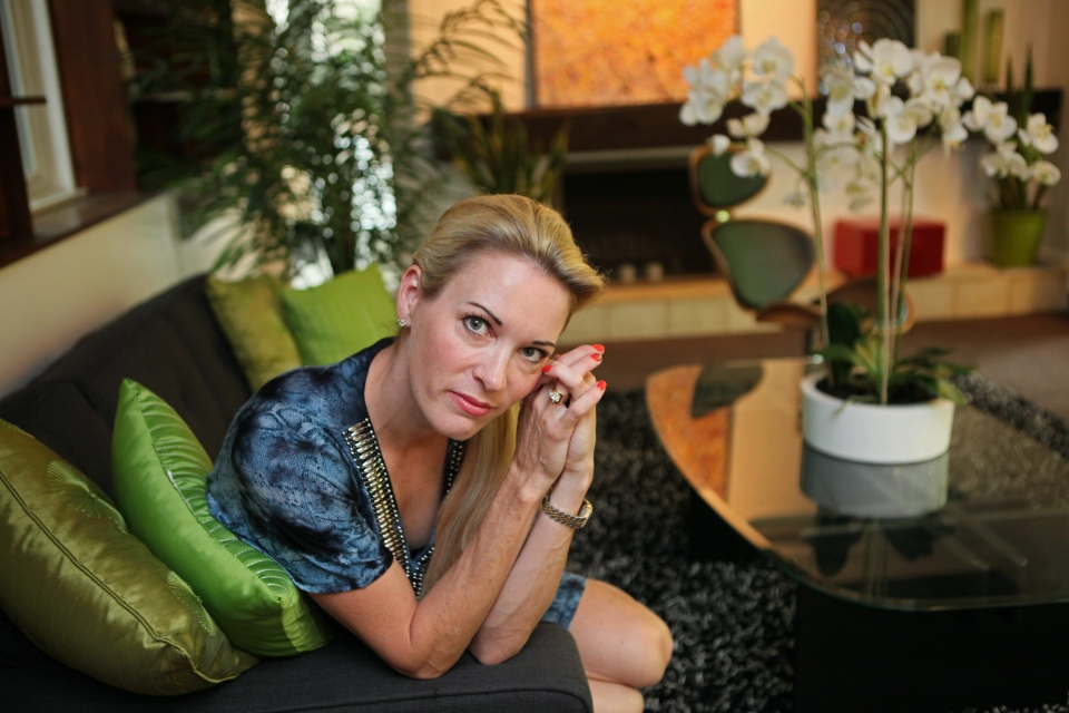 Suzy Favor Hamilton poses for a portrait at her home in Shorewood Hills a suburb of Madison, Wis., on  July 17, 2012. (Milwaukee Journal-Sentinel / Michael Sears)