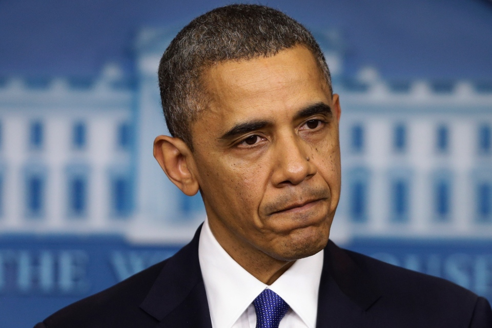 U.S. President Barack Obama pauses as he speaks to reporters about the fiscal cliff in the Brady Press Briefing Room at the White House in Washington, Dec. 21, 2012. (AP / Charles Dharapak)