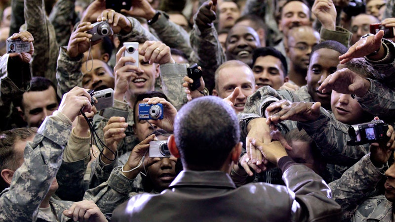 President Barack Obama greets members of the military at a rally during an unannounced visit at Bagram Air Field in Afghanistan, Friday, Dec. 3, 2010. (AP / Pablo Martinez Monsivais)