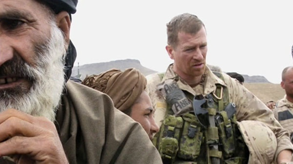 In this image, Captain Trevor Greene is seen on his first tour of duty in Afghanistan.