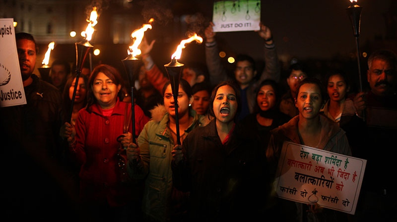 Indian protesters shout slogans as they march carrying torches near the Presidential Palace in New Delhi, India, Saturday, Dec. 22, 2012. (AP / Altaf Qadri)