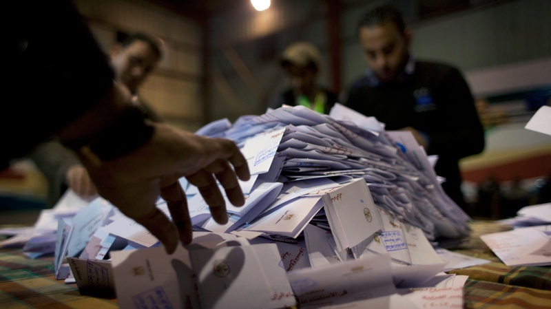 Egyptian election workers count ballots at the end of the second round of a referendum on a disputed constitution drafted by Islamist supporters of president Mohammed Morsi at a polling station in Giza, Egypt, Saturday, Dec. 22, 2012. (AP / Nasser Nasser)