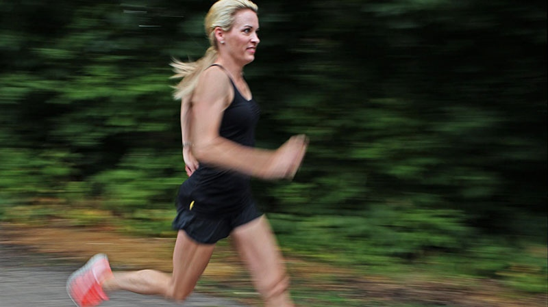 Suzy Favor Hamilton runs at her home in Shorewood Hills a suburb of Madison, Wis., July 17, 2012. (Milwaukee Journal-Sentinel, Michael Sears)
