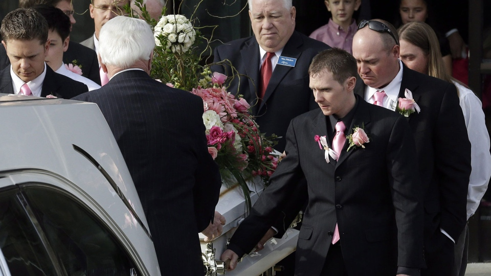 The casket of 6-year-old Emilie Parker is carried following funeral services in Ogden, Utah on Saturday, Dec. 22, 2012. (AP / Rick Bowmer)