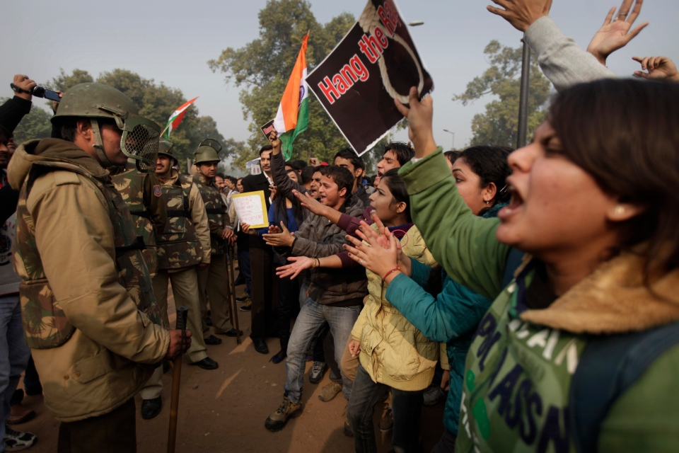 Indian protesters taunt Indian police officers during a protest in New Delhi, India, Sunday, Dec. 23, 2012. (AP Photo/Altaf Qadri)