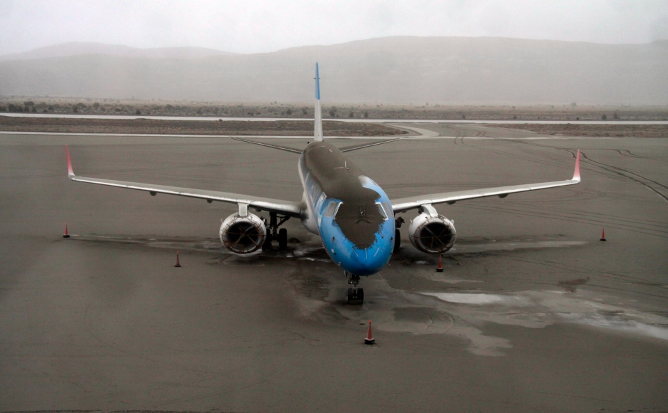 A plane dusted in volcanic ash sits grounded at the San Carlos de Bariloche airport, southern Argentina, June 7, 2011. (AP / Alfredo Leiva)