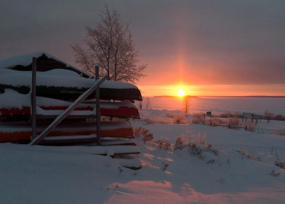 Canoes are stacked for the winter as the sun rises on the Fort Hope First Nation, Ont., Tuesday, Dec. 18, 2012. (Ryan Remiorz / THE CANADIAN PRESS)