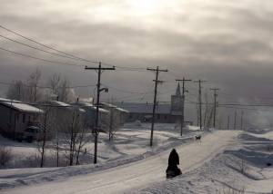 A snowmobile rides down the main street Tuesday, December 18, 2012, on the Fort Hope First Nation, Ont. THE CANADIAN PRESS/Ryan Remiorz
