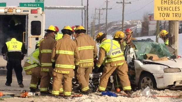 Firefighters transport a patient into the care of EMS following a Sunday morning crash on northbound Deerfoot Trail