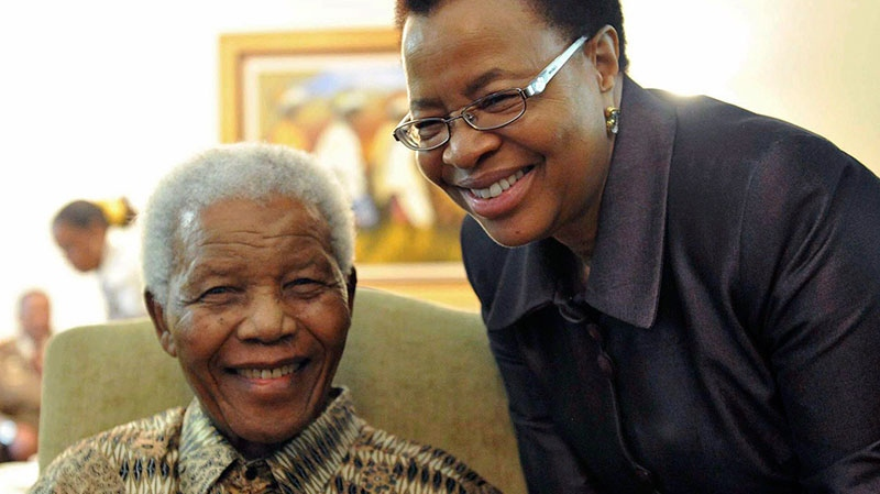 Former South African President Nelson Mandela and his wife Graca Machel pose for a photo after casting a ballot in a local elections at his home in Johannesburg, South Africa, on May 16, 2011. (Elmond Jiyane / GCIS)