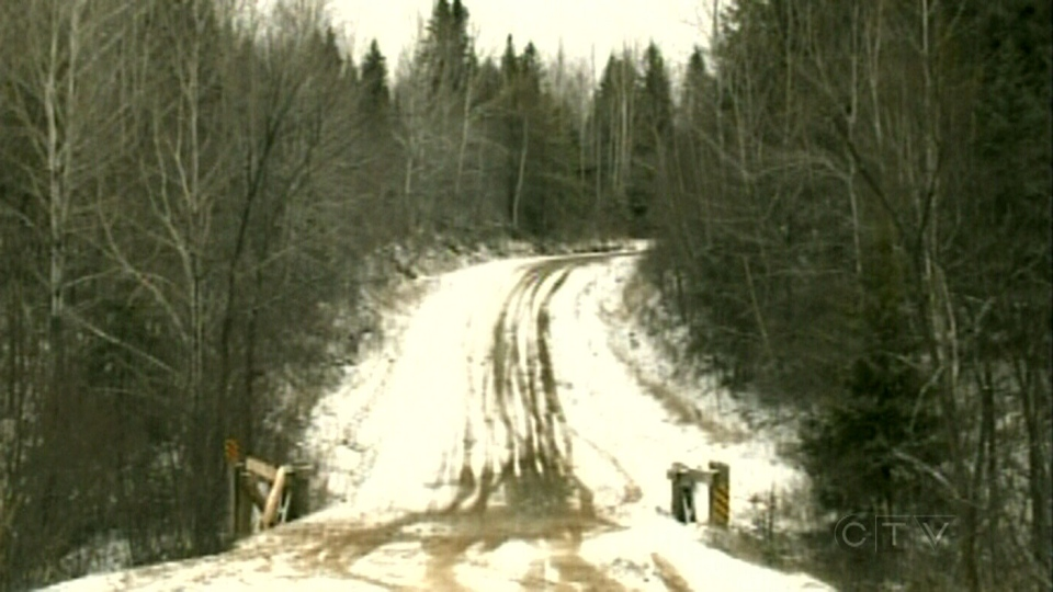 RCMP say the vehicle was trying to make its way up this hill when it spun out of control and plunged into the river near Tracadie-Sheila, N.B. on Saturday, Dec. 22, 2012.