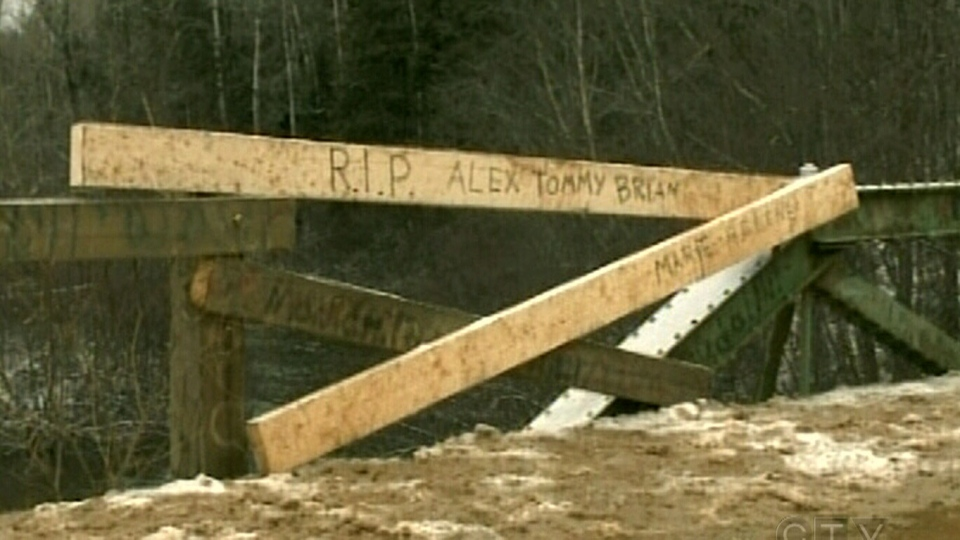 A memorial is set up for the four people that died near Tracadie-Sheila, N.B. on Saturday, Dec. 22, 2012.