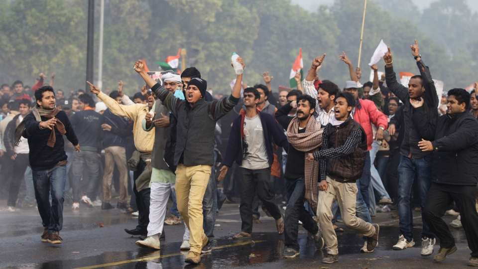 Indian protesters shout slogans during a protest in New Delhi, India, Sunday, Dec. 23, 2012. (AP / Altaf Qadri)