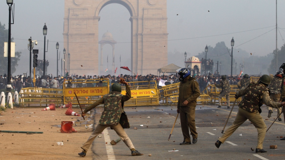 Indian protesters and policemen throw stones at each other during a protest in New Delhi, India, Sunday, Dec. 23, 2012. (AP / Altaf Qadri)