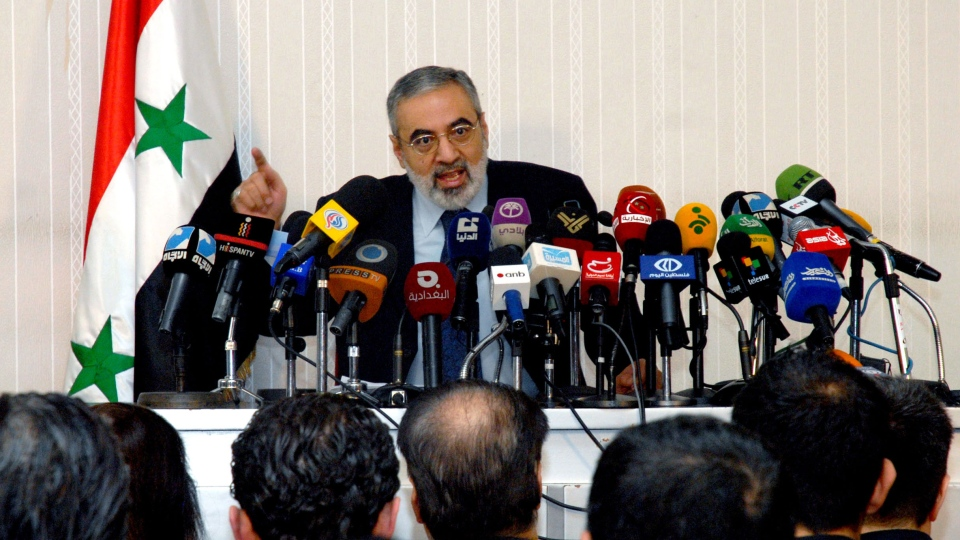 In this photo released by the Syrian official news agency SANA, Syrian Information Minister Omran al-Zoubi speaks during a press conference in Damascus, Syria, Sunday, Dec. 23, 2012. (AP / SANA)