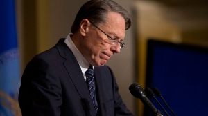 National Rifle Association executive vice president Wayne LaPierre pauses as he makes a statement during a news conference in response to the Connecticut school shooting, on Friday, Dec. 21, 2012 in Washington. (AP / Evan Vucci)