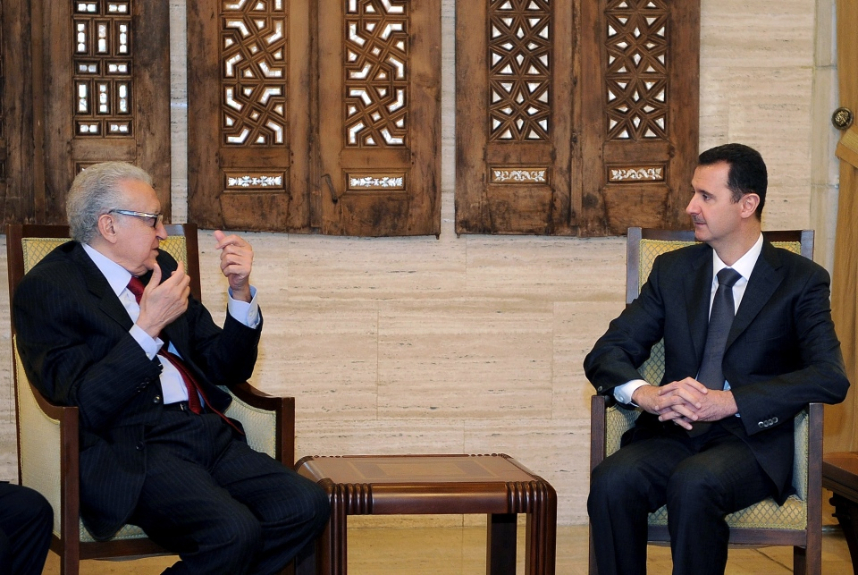 In this photo released by the Syrian official news agency SANA, Syrian President Bashar al-Assad, right, meets with UN Arab League deputy to Syria, Lakhdar Brahimi in Damascus, Syria, Monday, Dec. 24, 2012. (AP / SANA)