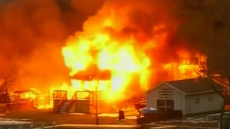 Fire rages after firefighters were shot while trying to respond to the massive blaze in Webster, N.Y., Monday, Dec. 24, 2012.