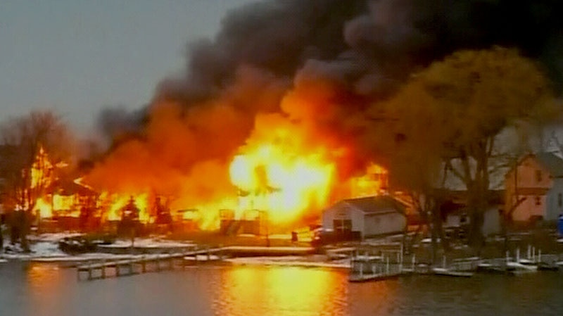 Houses continue to burn after firefighters were shot and killed while trying to respond to the blaze in Webster, N.Y., Monday, Dec. 24, 2012.