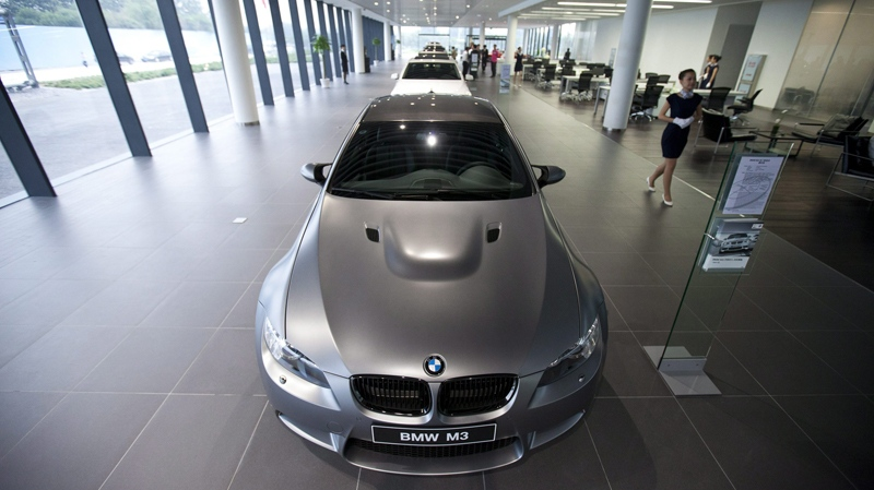 BMW cars are exhibited in the showroom of a newly opened BMW car dealership on June 18, 2012. (AP Photo/Alexander F. Yuan)