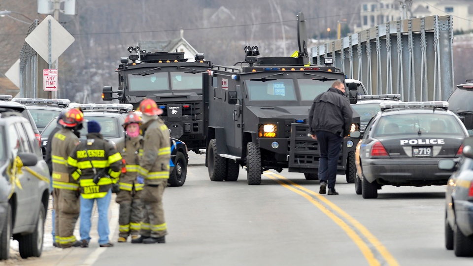 Swat teams appear at the scene of a fire in Webster, N.Y., Monday, Dec. 24, 2012. (AP / Messenger Post Media, Seth Binnix)