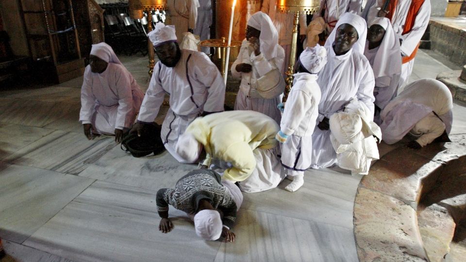 Christian worshippers from Nigeria pray at the Church of Nativity, traditionally believed by Christians to be the birthplace of Jesus Christ, in the West Bank town of Bethlehem, Monday, Dec. 24, 2012. (AP / Adel Hana)