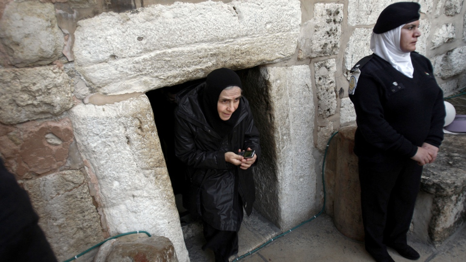 A Christian worshiper walks out of the Church of Nativity, traditionally believed by Christians to be the birthplace of Jesus Christ, in the West Bank town of Bethlehem, Monday, Dec. 24, 2012. (AP / Adel Hana)