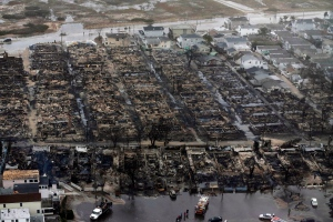 This Oct. 30, 2012 file aerial photo shows burned-out homes in the Breezy Point section of the Queens borough New York after Sandy swept through. (AP/Mike Groll, File)